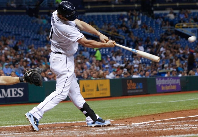 Jul 5, 2013; St. Petersburg, FL, USA; Tampa Bay Rays right fielder Wil Myers (9) hits a sacrifice RBI during the fourth inning against the Chicago White Sox at Tropicana Field. Mandatory Credit: Kim Klement-USA TODAY Sports