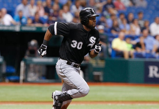 Jul 5, 2013; St. Petersburg, FL, USA; Chicago White Sox center fielder Alejandro De Aza (30) runs to first against the Tampa Bay Rays at Tropicana Field. Tampa Bay Rays defeated the Chicago White Sox 8-3. Mandatory Credit: Kim Klement-USA TODAY Sports