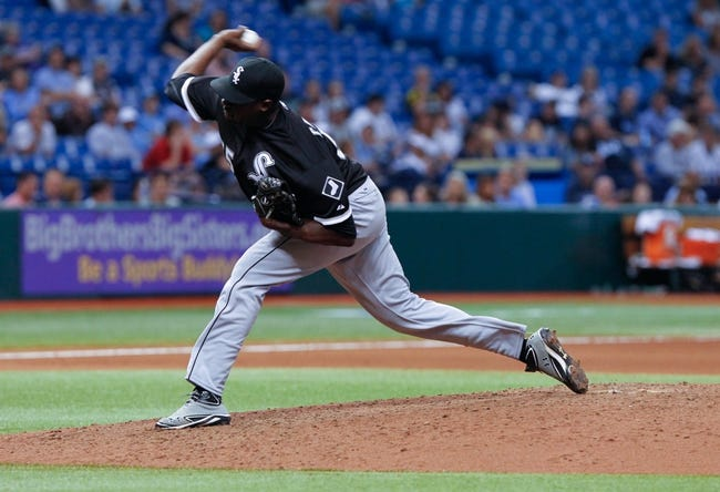Jul 5, 2013; St. Petersburg, FL, USA; Chicago White Sox pitcher Simon Castro (55) throws a pitch against the Tampa Bay Rays at Tropicana Field. Tampa Bay Rays defeated the Chicago White Sox 8-3. Mandatory Credit: Kim Klement-USA TODAY Sports