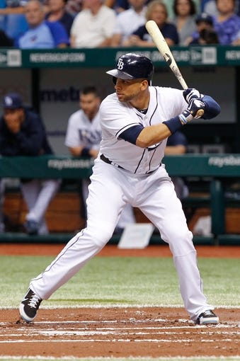 Jul 5, 2013; St. Petersburg, FL, USA; Tampa Bay Rays first baseman James Loney (21) at bat against the Chicago White Sox at Tropicana Field. Mandatory Credit: Kim Klement-USA TODAY Sports