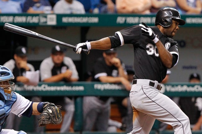 Jul 5, 2013; St. Petersburg, FL, USA; Chicago White Sox center fielder Alejandro De Aza (30) at bat against the Tampa Bay Rays at Tropicana Field. Tampa Bay Rays defeated the Chicago White Sox 8-3. Mandatory Credit: Kim Klement-USA TODAY Sports