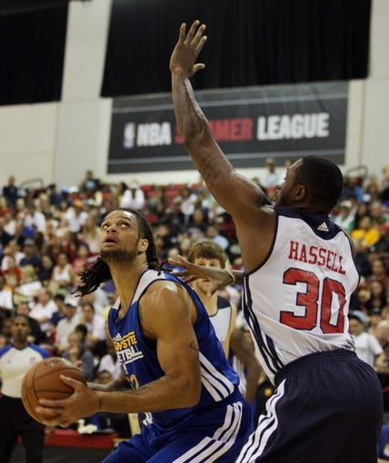 Jul 13, 2013; Las Vegas, NV, USA; Golden State Warriors center Gary McGhee eyes the basket while being defended by Washington Wizards forward Frank Hassell during the first quarter of Summer League play at the Cox Pavillion. Mandatory Credit: Stephen R. Sylvanie-USA TODAY Sports