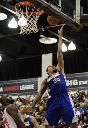 Jul 13, 2013; Las Vegas, NV, USA; Golden State guard Kent Bazemore shoots as Washington Wizards forward Chris Singleton looks on during the second quarter of their Summer League match at the Cox Pavillion. Mandatory Credit: Stephen R. Sylvanie-USA TODAY Sports