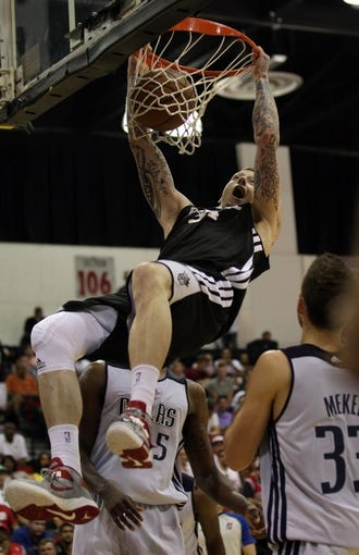 Jul 13, 2013; Las Vegas, NV, USA; Sacramento Kings forward Nick Minnerath dunks the ball against the Dallas Mavericks during the second quarter of an NBA Summer League game at Cox Pavillion. Mandatory Credit: Stephen R. Sylvanie-USA TODAY Sports