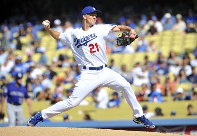July 13, 2013; Los Angeles, CA, USA; Los Angeles Dodgers starting pitcher Zack Greinke (21) pitches during the first inning against the Colorado Rockies at Dodger Stadium. Mandatory Credit: Gary A. Vasquez-USA TODAY Sports