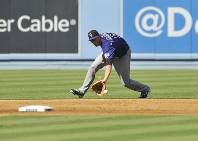July 13, 2013; Los Angeles, CA, USA; Colorado Rockies second baseman DJ LeMahieu (9) fields a ground ball in the second inning against the Los Angeles Dodgers at Dodger Stadium. Mandatory Credit: Gary A. Vasquez-USA TODAY Sports