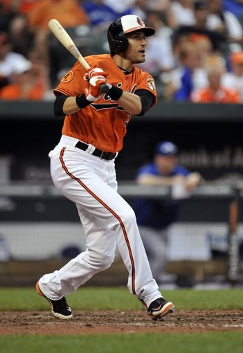 Jul 13, 2013; Baltimore, MD, USA; Baltimore Orioles pinch hitter Ryan Flaherty (3) singles in the ninth inning against the Toronto Blue Jays at Oriole Park at Camden Yards. The Blue Jays defeated the Orioles 7-3. Mandatory Credit: Joy R. Absalon-USA TODAY Sports