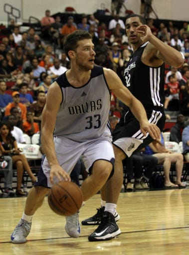 Jul 13, 2013; Las Vegas, NV, USA; Dallas Mavericks guard Gal Mekel dribbles the ball around Sacramento Kings forward Drew Gordon during the second half of an NBA Summer League game at Cox Pavillion. Mandatory Credit: Stephen R. Sylvanie-USA TODAY Sports