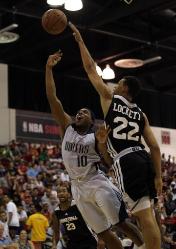 Jul 13, 2013; Las Vegas, NV, USA; Sacramento Kings guard Trent Lockett deflects a shot attempt by Dallas Mavericks guard Josh Akognon during the third quarter of a Summer League game at Cox Pavillion. Also pictured in the play is Sacramento Kings guard David Lightly. Mandatory Credit: Stephen R. Sylvanie-USA TODAY Sports