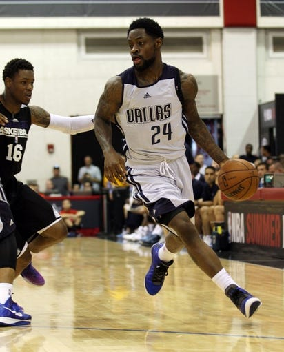 Jul 13, 2013; Las Vegas, NV, USA; Dallas Mavericks guard Terrico White dribbles the ball around Sacramento Kings guard Ben McLemore during the second half of an NBA Summer League game at Cox Pavillion. Mandatory Credit: Stephen R. Sylvanie-USA TODAY Sports