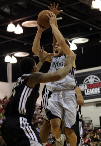 Jul 13, 2013; Las Vegas, NV, USA; Dallas Mavericks guard Gal Mekel drives the ball toward the basket through Sacramento Kings guard David Light during the third quarter of an NBA Summer League game at Cox Pavillion. Mandatory Credit: Stephen R. Sylvanie-USA TODAY Sports