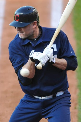 Jul 13, 2013; Cleveland, OH, USA; Cleveland Indians designated hitter Jason Giambi (25) is hit by a pitch in the second inning against the Kansas City Royals at Progressive Field. Mandatory Credit: David Richard-USA TODAY Sports