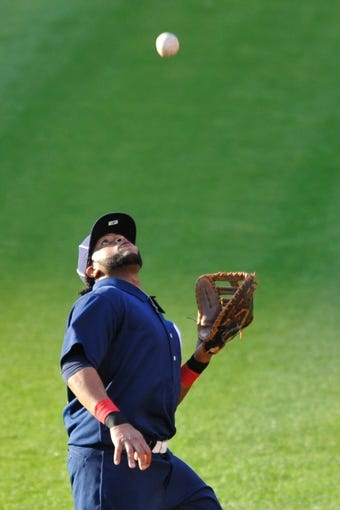 Jul 13, 2013; Cleveland, OH, USA; Cleveland Indians first baseman Carlos Santana (41) makes a catch on a foul pop in the third inning against the Kansas City Royals at Progressive Field. Mandatory Credit: David Richard-USA TODAY Sports