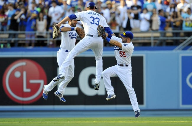 July 13, 2013; Los Angeles, CA, USA; Los Angeles Dodgers right fielder Andre Ethier (16), right fielder Scott Van Slyke (33) and left fielder Skip Schumaker (55) celebrate the 1-0 victory against the Colorado Rockies at Dodger Stadium. Mandatory Credit: Gary A. Vasquez-USA TODAY Sports