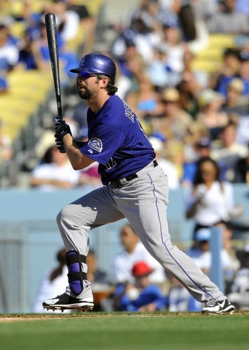 July 13, 2013; Los Angeles, CA, USA; Colorado Rockies first baseman Todd Helton (17) hits a single during the fifth inning against the Los Angeles Dodgers at Dodger Stadium. Mandatory Credit: Gary A. Vasquez-USA TODAY Sports