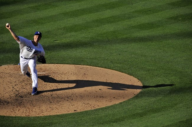 July 13, 2013; Los Angeles, CA, USA; Los Angeles Dodgers starting pitcher Zack Greinke (21) pitches during the seventh inning against the Colorado Rockies at Dodger Stadium. Mandatory Credit: Gary A. Vasquez-USA TODAY Sports