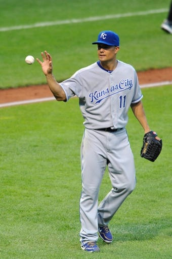 Jul 13, 2013; Cleveland, OH, USA; Kansas City Royals starting pitcher Jeremy Guthrie (11) reacts after giving up consecutive hits against the Cleveland Indians in the sixth inning at Progressive Field. Mandatory Credit: David Richard-USA TODAY Sports
