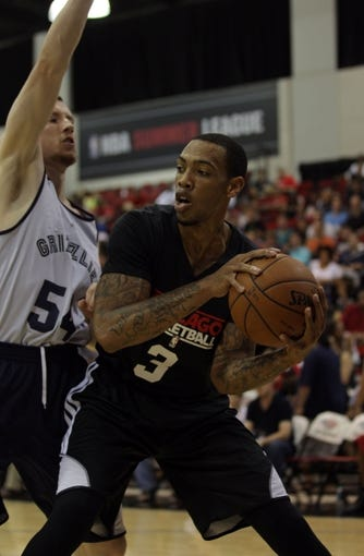 Jul 13, 2013; Las Vegas, NV, USA; Chicago Bulls forward Malcom Thomas protects the ball from Memphis Grizzlies forward Matt Howard during the first half of an NBA Summer League game at Cox Pavillion. Mandatory Credit: Stephen R. Sylvanie-USA TODAY Sports