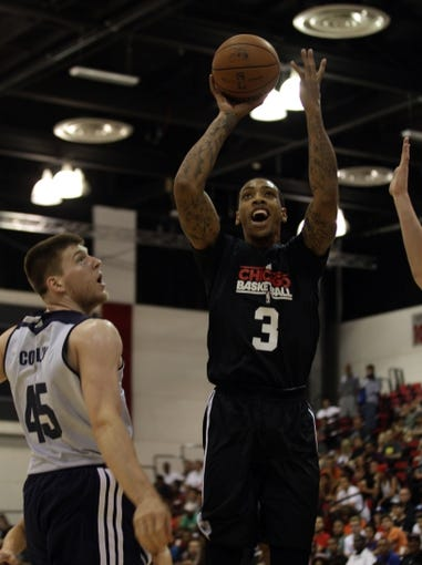 Jul 13, 2013; Las Vegas, NV, USA; Chicago Bulls forward Malcolm Thomas lunges toward the basket past Memphis Grizzlies center Jack Cooley during the first half of an NBA Summer League game at Cox Pavillion. Mandatory Credit: Stephen R. Sylvanie-USA TODAY Sports