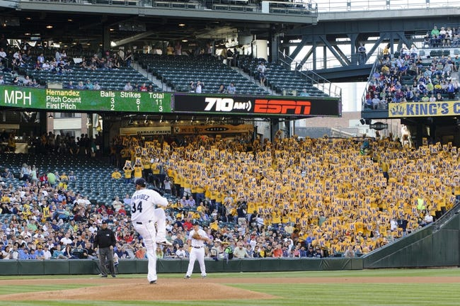 Jul 13, 2013; Seattle, WA, USA; Seattle Mariners starting pitcher Felix Hernandez (34) pitches with the King's Court in the background during the game against the Los Angeles Angels at Safeco Field. Seattle defeated Los Angeles 6-0. Mandatory Credit: Steven Bisig-USA TODAY Sports