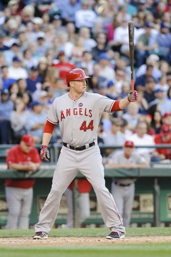 Jul 13, 2013; Seattle, WA, USA; Los Angeles Angels first baseman Mark Trumbo (44) waits for the pitch during the game against the Seattle Mariners at Safeco Field. Seattle defeated Los Angeles 6-0. Mandatory Credit: Steven Bisig-USA TODAY Sports