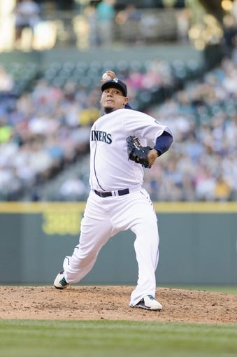Jul 13, 2013; Seattle, WA, USA; Seattle Mariners starting pitcher Felix Hernandez (34) pitches to the Los Angeles Angels during the game at Safeco Field. Seattle defeated Los Angeles 6-0. Mandatory Credit: Steven Bisig-USA TODAY Sports