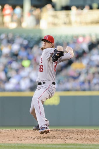 Jul 13, 2013; Seattle, WA, USA; Los Angeles Angels starting pitcher Jered Weaver (36) pitches to the Seattle Mariners during the game at Safeco Field. Seattle defeated Los Angeles 6-0. Mandatory Credit: Steven Bisig-USA TODAY Sports