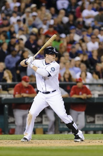 Jul 13, 2013; Seattle, WA, USA; Seattle Mariners first baseman Justin Smoak (17) waits for the pitch during the game against the Los Angeles Angels at Safeco Field. Seattle defeated Los Angeles 6-0. Mandatory Credit: Steven Bisig-USA TODAY Sports