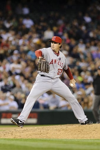 Jul 13, 2013; Seattle, WA, USA; Los Angeles Angels relief pitcher Scott Downs (37) pitches to the Seattle Mariners during the game at Safeco Field. Seattle defeated Los Angeles 6-0. Mandatory Credit: Steven Bisig-USA TODAY Sports