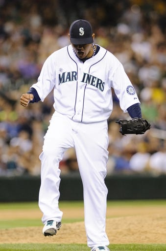 Jul 13, 2013; Seattle, WA, USA; Seattle Mariners starting pitcher Felix Hernandez (34) reacts to the Mariners getting the final out of the 8th inning against the Los Angeles Angels at Safeco Field. Seattle defeated Los Angeles 6-0. Mandatory Credit: Steven Bisig-USA TODAY Sports