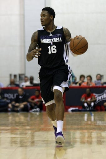Jul 13, 2013; Las Vegas, NV, USA; Sacramento Kings guard Ben McLemore dribbles the ball down the court against the Dallas Mavericks during an NBA Summer League game at Cox Pavillion. Mandatory Credit: Stephen R. Sylvanie-USA TODAY Sports