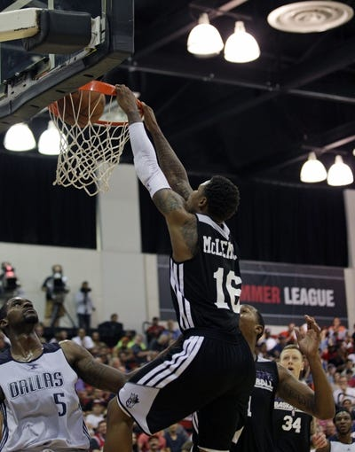 Jul 13, 2013; Las Vegas, NV, USA; Sacramento Kings guard Ben McLemore (16) dunks the ball over Dallas Mavericks center Bernard James (5) during the first quarter of an NBA Summer League game at Cox Pavillion . Mandatory Credit: Stephen R. Sylvanie-USA TODAY Sports