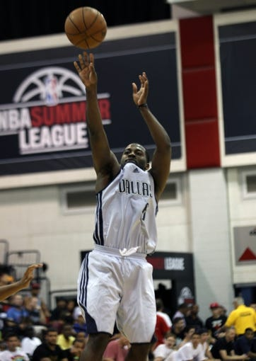 Jul 13, 2013; Las Vegas, NV, USA; Dallas Mavericks guard Justin Dentmon shoots the ball against the Sacramento Kings during an NBA Summer League game at Cox Pavillion. Mandatory Credit: Stephen R. Sylvanie-USA TODAY Sports