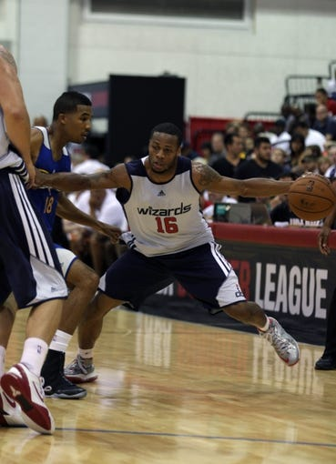 Jul 13, 2013; Las Vegas, NV, USA; Washington Wizards guard Marquez Haynes (16) dribbles the ball against Golden State Warriors guard Kwame Vaughn during the second half of an NBA Summer League game at Cox Pavillion. Mandatory Credit: Stephen R. Sylvanie-USA TODAY Sports