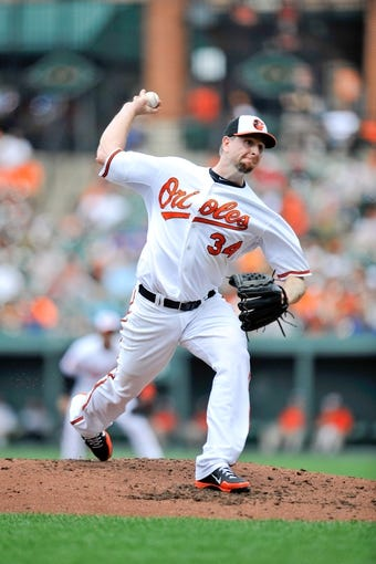 Jul 14, 2013; Baltimore, MD, USA; Baltimore Orioles starting pitcher Scott Feldman (34) throws in the third inning against the Toronto Blue Jays at Oriole Park at Camden Yards. Mandatory Credit: Joy R. Absalon-USA TODAY Sports