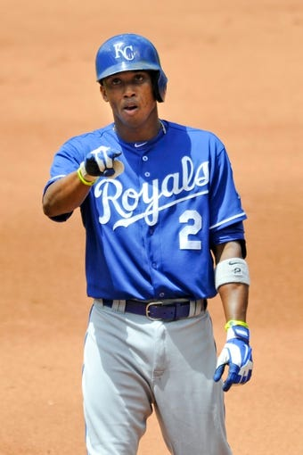 Jul 14, 2013; Cleveland, OH, USA; Kansas City Royals shortstop Alcides Escobar (2) celebrates his RBI single in the fourth inning against the Cleveland Indians at Progressive Field. Mandatory Credit: David Richard-USA TODAY Sports