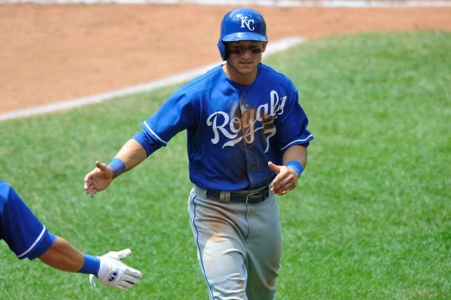Jul 14, 2013; Cleveland, OH, USA; Kansas City Royals right fielder David Lough (7) is congratulated after scoring in the fourth inning against the Cleveland Indians at Progressive Field. Mandatory Credit: David Richard-USA TODAY Sports