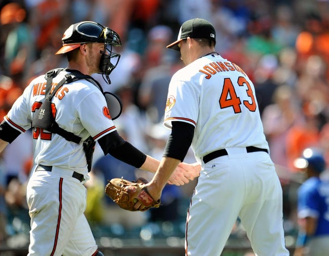 Jul 14, 2013; Baltimore, MD, USA; Baltimore Orioles catcher Matt Wieters (32) congratulates pitcher Jim Johnson (43) after a game against the Toronto Blue Jays at Oriole Park at Camden Yards. The Orioles defeated the Blue Jays 7-4. Mandatory Credit: Joy R. Absalon-USA TODAY Sports