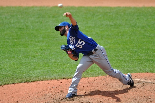 Jul 14, 2013; Cleveland, OH, USA; Kansas City Royals relief pitcher Tim Collins (55) delivers in the sixth inning against the Cleveland Indians at Progressive Field. Mandatory Credit: David Richard-USA TODAY Sports