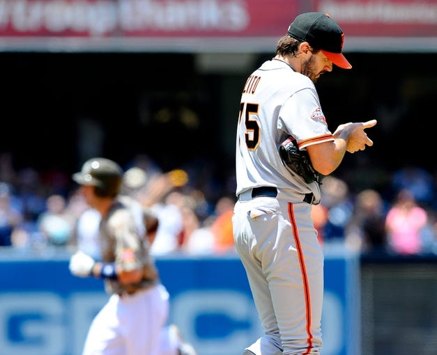 Jul 14, 2013; San Diego, CA, USA; San Francisco Giants starting pitcher Barry Zito (75) reacts after a solo home run by San Diego Padres right fielder Chris Denorfia (back) during the first inning at Petco Park. Mandatory Credit: Christopher Hanewinckel-USA TODAY Sports