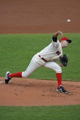 Jul 14, 2013; Cleveland, OH, USA; Cleveland Indians starting pitcher Ubaldo Jimenez (30) delivers in the second inning against the Kansas City Royals at Progressive Field. Mandatory Credit: David Richard-USA TODAY Sports
