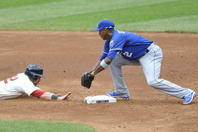 Jul 14, 2013; Cleveland, OH, USA; Cleveland Indians second baseman Jason Kipnis (22) dives safely back to second base before a tag by Kansas City Royals shortstop Alcides Escobar (2) in the third inning at Progressive Field. Mandatory Credit: David Richard-USA TODAY Sports