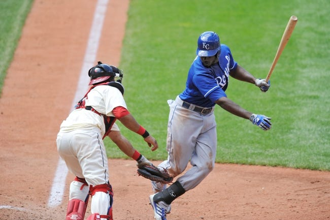 Jul 14, 2013; Cleveland, OH, USA; Cleveland Indians catcher Carlos Santana (41) tags out Kansas City Royals center fielder Lorenzo Cain (6) on a strikeout in the seventh inning at Progressive Field. Mandatory Credit: David Richard-USA TODAY Sports