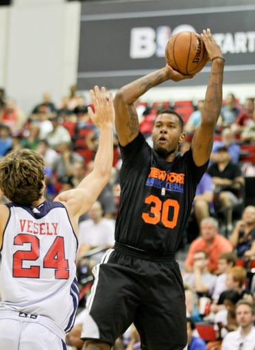 Jul 14, 2013; Las Vegas, NV, USA; New York Nicks forward Jeremy Tyler looks for an open teammate while being defended by Washington Wizards forward Jan Vesely during an NBA Summer League game at Cox Pavillion. Mandatory Credit: Stephen R. Sylvanie-USA TODAY Sports