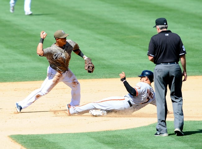 Jul 14, 2013; San Diego, CA, USA; San Diego Padres shortstop Everth Cabrera (2) turns a double play ahead of the slide by San Francisco Giants center fielder Gregor Blanco (7) to end the seventh inning  at Petco Park. Mandatory Credit: Christopher Hanewinckel-USA TODAY Sports