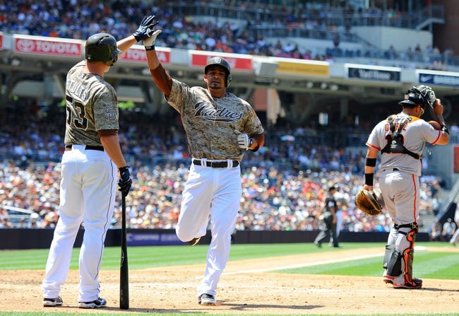 Jul 14, 2013; San Diego, CA, USA; San Diego Padres first baseman Jesus Guzman (15) is congratulated by starting pitcher Eric Stults (53)after scoring during the third inning against the San Francisco Giants at Petco Park. Mandatory Credit: Christopher Hanewinckel-USA TODAY Sports