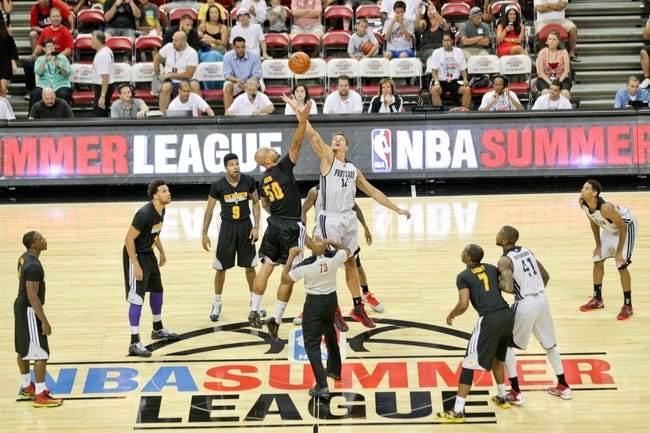 Jul 14, 2013; Las Vegas, NV, USA; Los Angeles Lakers center Robert Sacre and Portland Trailblazers center Meyers Leonard vie for the tip off at the start of an NBA Summer League game at the Thomas and Mack Center . Mandatory Credit: Stephen R. Sylvanie-USA TODAY Sports