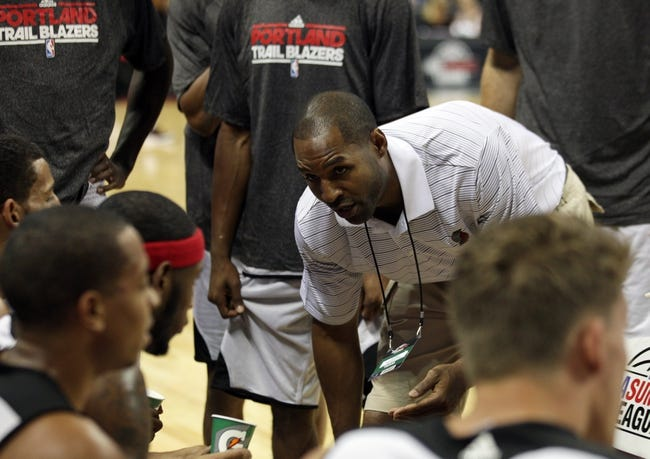 Jul 14, 2013; Las Vegas, NV, USA; Portland Trailblazers coach David Vanterpool leans in to talk to his team during a first quarter time out while facing the Los Angeles Lakers in an NBA Summer League game at the Thomas and Mack Center. Mandatory Credit: Stephen R. Sylvanie-USA TODAY Sports