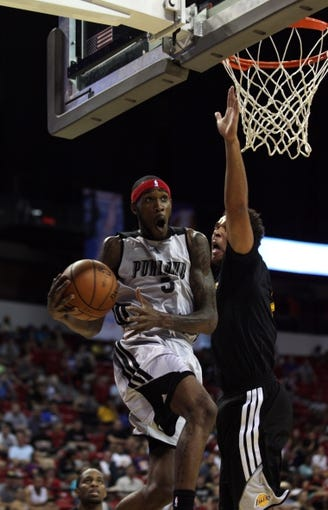 Jul 14, 2013; Las Vegas, NV, USA; Portland Trailblazers guard Will Barton lunges under the basket inside the defense of Los Angeles Lakers forward Elias Harris during an NBA Summer League game at the Thomas and Mack Center. Mandatory Credit: Stephen R. Sylvanie-USA TODAY Sports