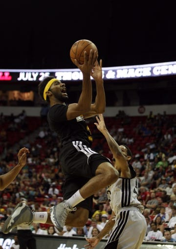 Jul 14, 2013; Las Vegas, NV, USA; Los Angeles Lakers forward Lazar Hayward reacts after being fouled by Portland Trailblazers guard Allen Crabbe during an NBA Summer League game at the Thomas and Mack Center. Mandatory Credit: Stephen R. Sylvanie-USA TODAY Sports